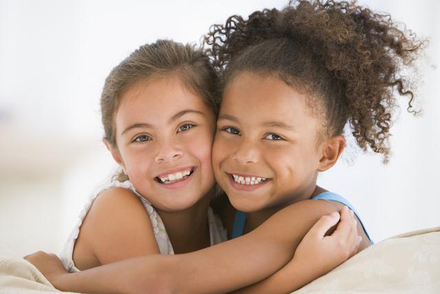 Homeschool friends hugging