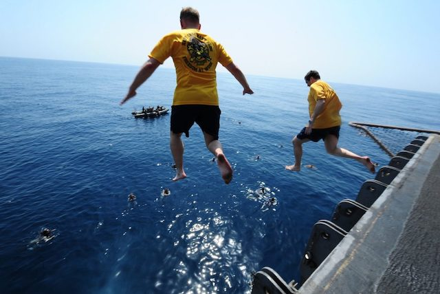 People jumping off a ship