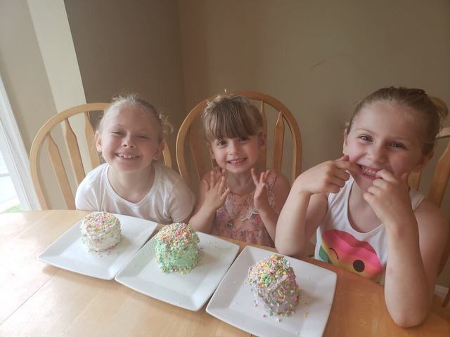 homeschool kids smiling with their finished cakes
