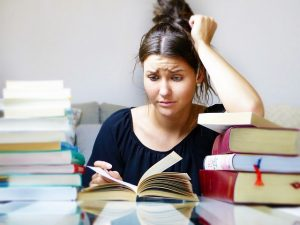 Stressed woman reading a book