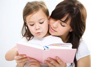Mother reading to homeschool preschool child.