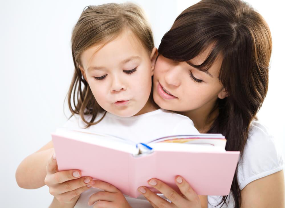 Consistent homeschool mother reading to homeschool preschool child.
