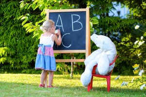 Homeschool Preschool girl writing ABCs