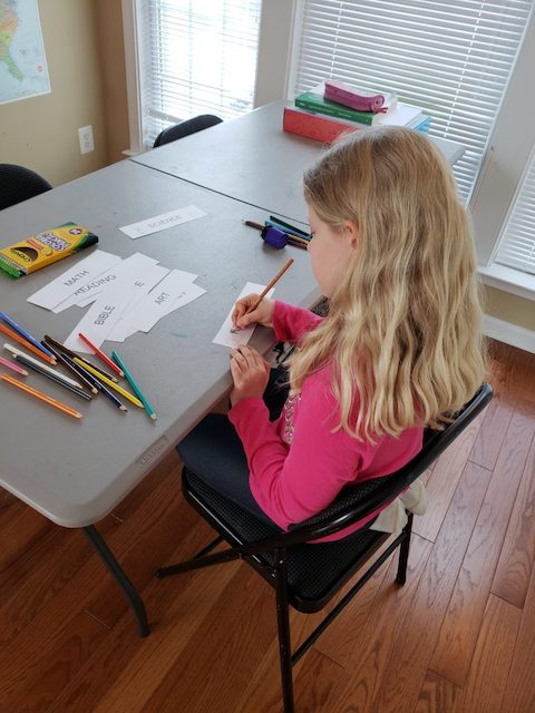 Homeschool Kid coloring her routine cards