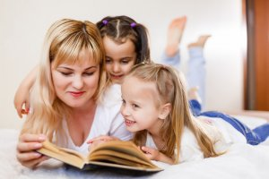 Homeschool Mom reading a chapter book to her reluctant readers