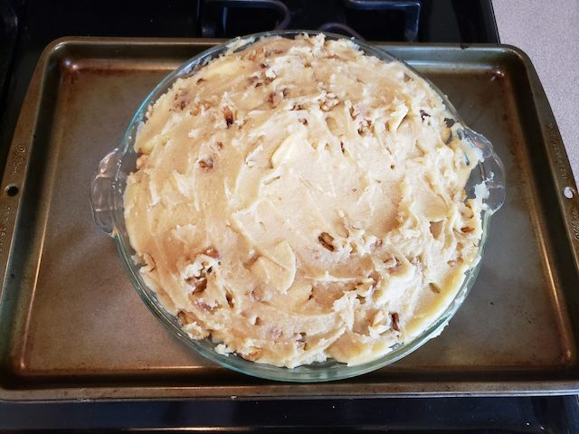 Apple pie made by kids about to go into the oven