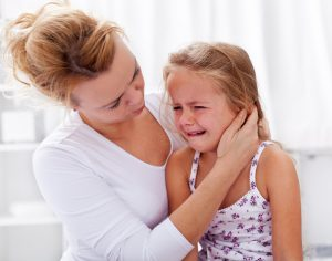 homeschool mom comforting crying child