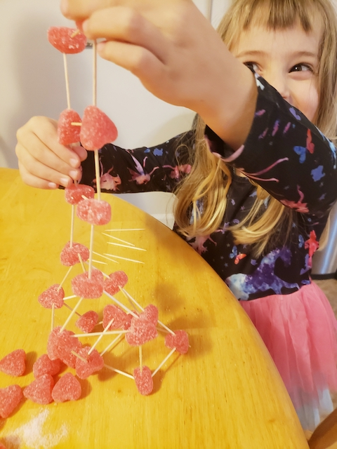 Preschooler working on Valentine's Day STEM Activity