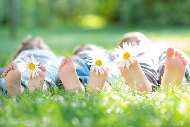 Healthy weight homeschoolers resting in the grass