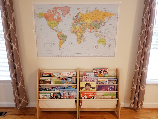Homeschool room bookcases and maps