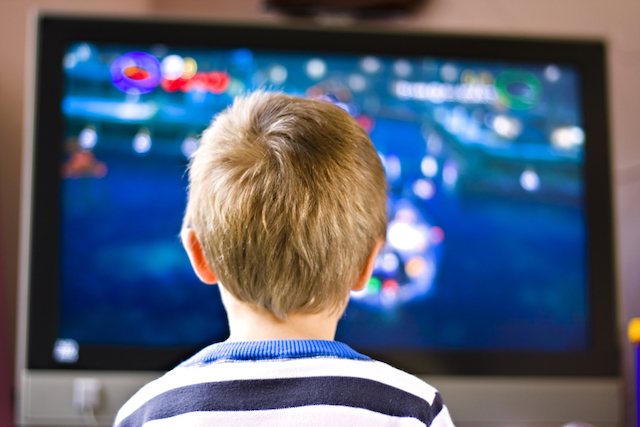 Kid watching TV instead of reading books