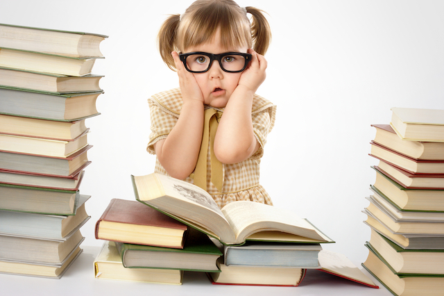 Little girl being taught too early to read