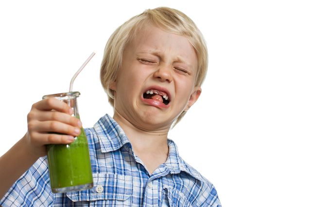 Boy does not want to eat green smoothie