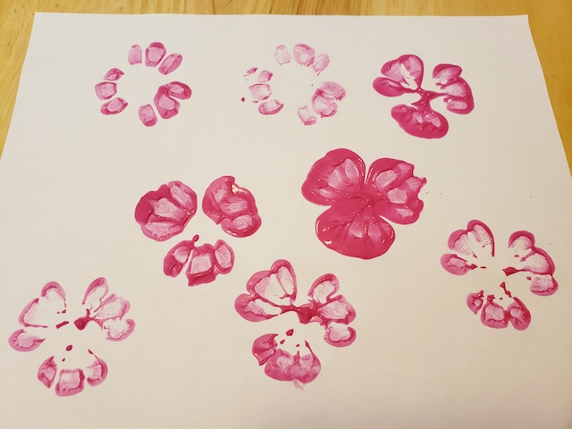 Scratch paper with water bottle flower stamps