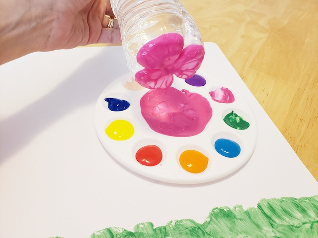 Water bottle with paint on the bottom for kids flower craft