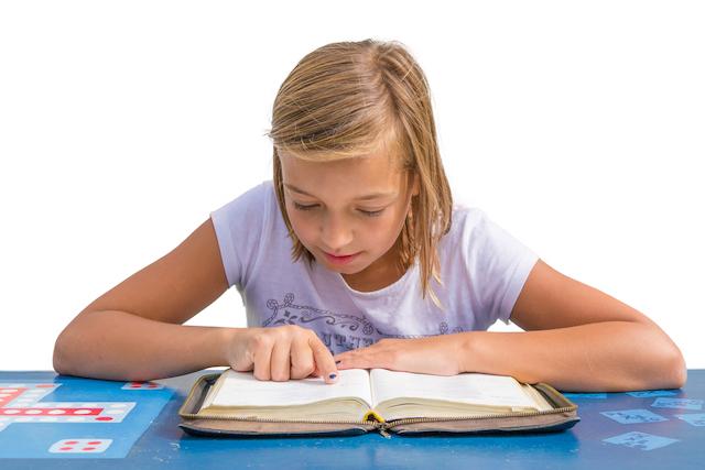 Homeschool kid studying Bible