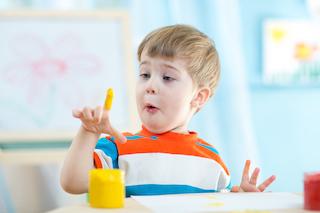 homeschool kindergarten boy with paint