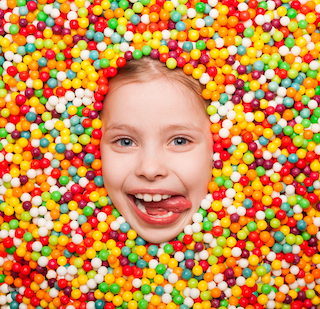 homeschool kid covered in candy from bribing or rewards