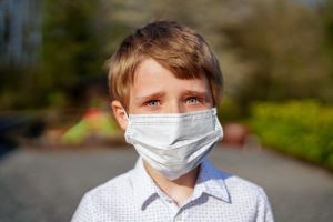 kid wearing face mask who wishes he had a virtual activity to do