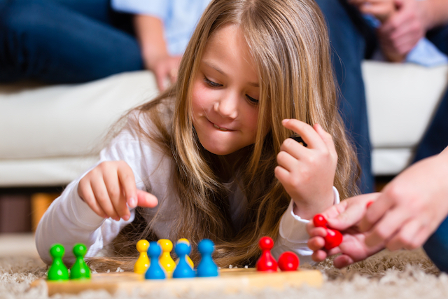 Homeschool girl using kindergarten tip to play a game