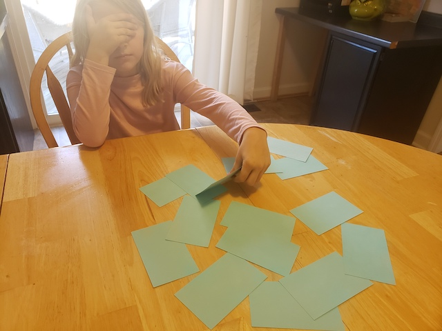 Homeschool kid playing Are You Feeling Lucky Flashcard Game