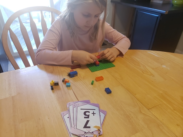 Kid playing Build a Tower Flashcard Game