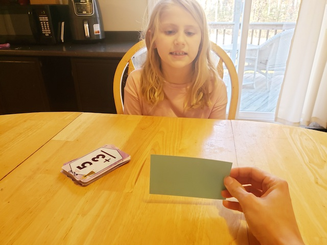 Save a Life Flashcard Game with 1st grader