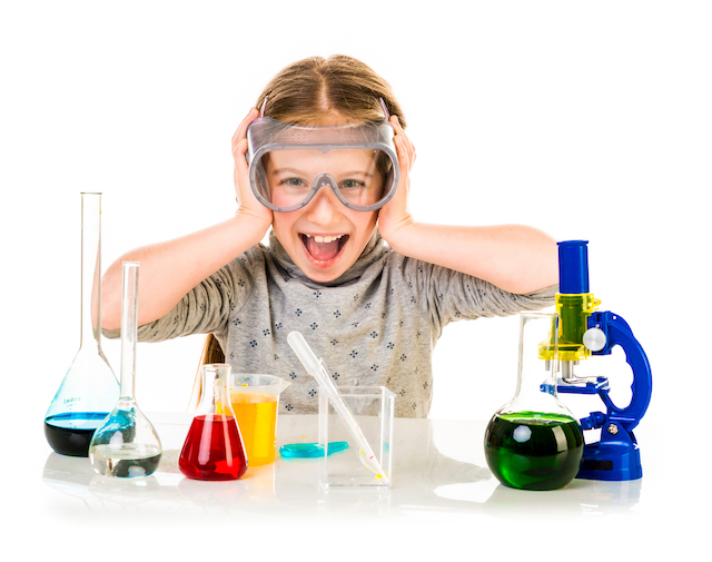 homeschool kid working with science materials
