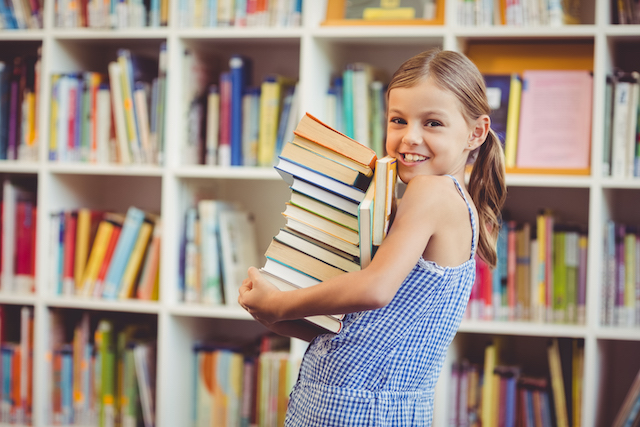 girl at library with free homeschool resources