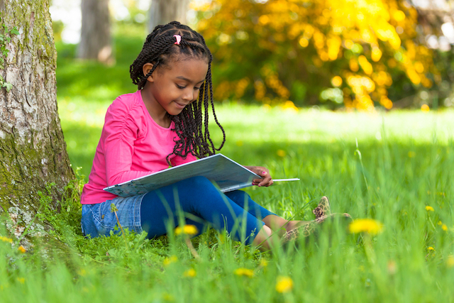 Kid happily reading at an appropriate reading level