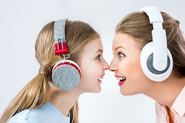 Mom and daughter wearing headphones