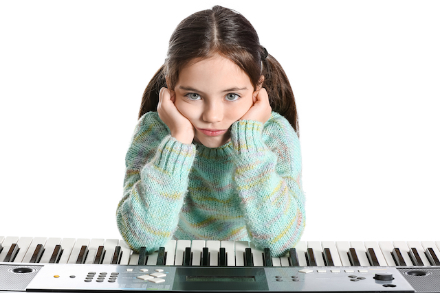 bored girl with elbows on a keyboard