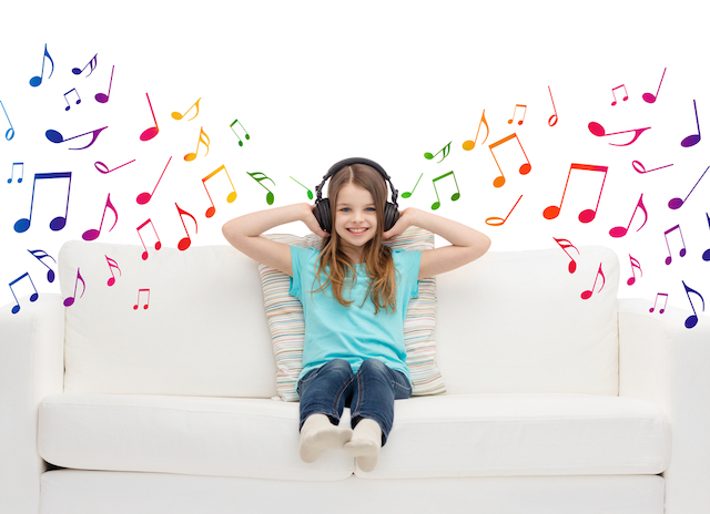 girl on couch listening to music