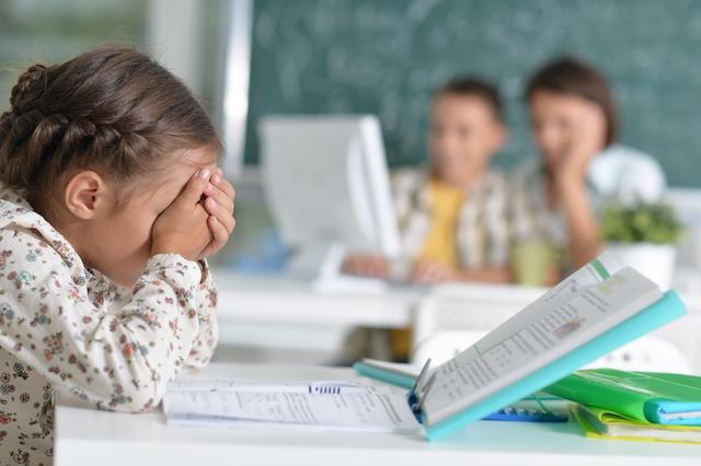 frustrated kid in public school classroom