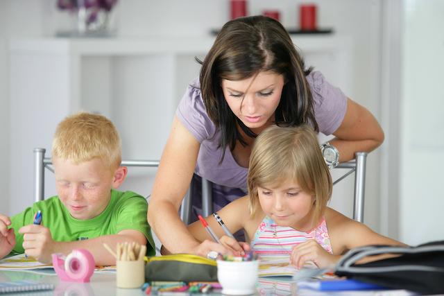 encouraged homeschool mom working with kids