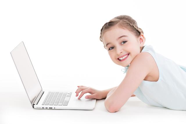 Kid on Laptop Doing Veritas Press History